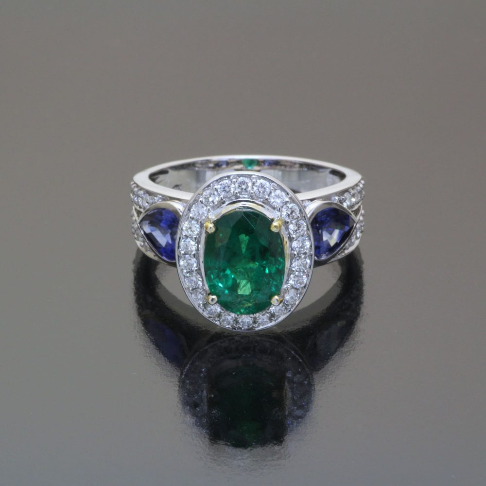 Emerald and sapphire ring with diamonds by Caram