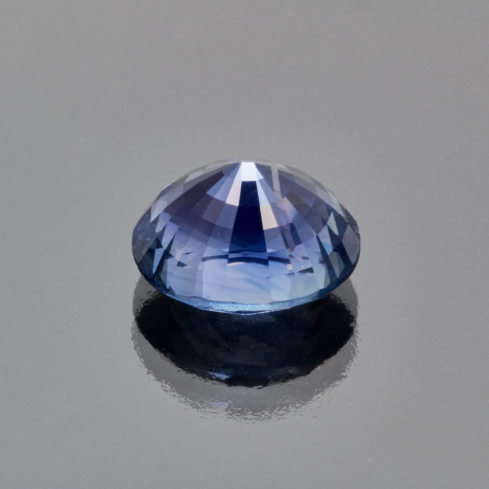 Indigo teal sapphire oval by Caram_back view