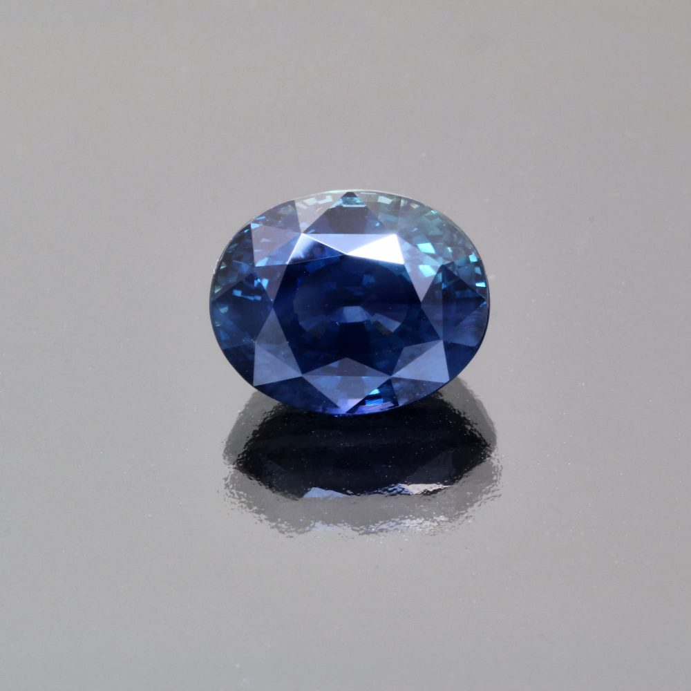 Indigo teal sapphire oval by Caram_front view