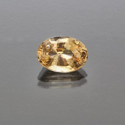 Orangy yellow sapphire oval no heat by Caram_front view